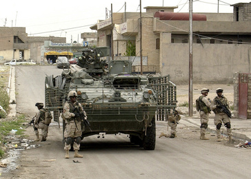 Soldiers of Comanche Company 1-23 Infantry, 3rd Brigade, 2nd Infantry Division Stryker Brigade Combat Team (SBCT) dismount a Stryker Infantry Carrier Vehicle (ICV)  to do a foort march in Mosul, Iraq on May 13, 2004. 