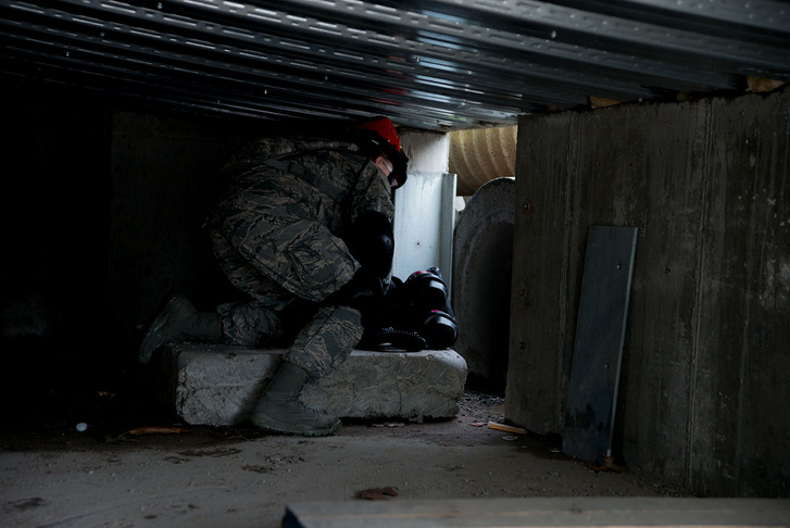 Senior Airman Tanya Rego, a medic from the 102nd Medical Group, Massachusetts Air National Guard, prepares to enter a tunnel during a confined space search and rescue mission. (Photo: Sgt. Steven Eaton/Public Domain)