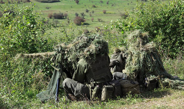 Austrian snipers observe the area. (Photo: EUFOR)